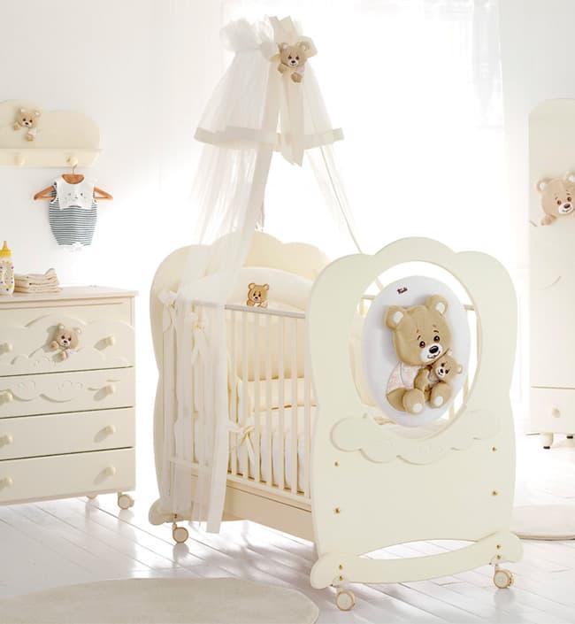 Кровать Baby Expert Abbracci by TrudiКровати<br>Детская кровать ABBRACCI- TRUDI крем<br><br>Цвет: Крем<br>Габариты ( В х Ш х Д ), см: 120х82х136